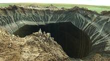 This frame grab made Wednesday, July 16, 2014, shows a crater, discovered recently in the Yamal Peninsula, in Yamalo-Nenets Autonomous Okrug, Russia. (Associated Press)