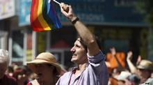 Justin Trudeau waves at the crowds at the Gay Pride Parade in Toronto on June 30, 2013. (Gloria Nieto/The Globe and Mail)