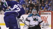 Vancouver Canucks Dale Weise (L) is stopped by San Jose Sharks goaltender Antti Niemi during the first period of their NHL game in Vancouver, British Columbia March 5, 2013. (BEN NELMS/REUTERS)