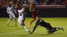 Vancouver Whitecaps midfielder Nicolas Mezquida scores a goal on Real Salt Lake goalkeeper Nick Rimando during the second half at Rio Tinto Stadium in Sandy, Utah on April 26. (Kelvin Kuo/USA Today Sports)
