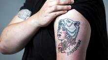 John Semley's 'Mother Canada' tattoo, which, he realized, both sends up and – in its severe ironicism – embodies the essence of Canadian humour. (Matthew Sherwood for The Globe and Mail)