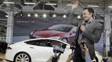 In this June 22, 2012 file photo, Tesla CEO Elon Musk waves during a rally at the Tesla factory in Fremont, Calif. Tesla Motors has selected Nevada for a massive, $5 billion factory that it will build to pump out batteries for a new generation of electric cars, a person familiar with the company's plans said Wednesday, Sept. 3, 2014. (Paul Sakuma/AP Photo)
