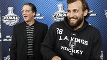 Los Angeles Kings President and General Manager Dean Lombardi (L) jokes with player Jarret Stoll during Media Day before Game 1 of their NHL Stanley Cup hockey final against the New Jersey Devils in Newark, New Jersey May 29, 2012. (Reuters)