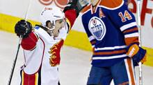Calgary Flames' Mikael Backlund (11) celebrates the win in overtime as Edmonton Oilers Jordan Eberle (14) skates past during NHL action in Edmonton, Alta., on Saturday December 7, 2013. (JASON FRANSON/THE CANADIAN PRESS)
