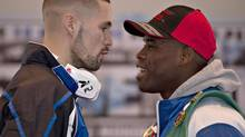 WBC light heavyweight titleholder Adonis Stevenson, right, and contender Tony Bellew, face each other during a news conference Wednesday, November 27, 2013 in Quebec City. Stevenson will fight Bellew of Liverpool, England in a championship fight on Saturday Nov. 30. (JACQUES BOISSINOT/THE CANADIAN PRESS)