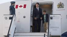 Canadian Prime Minister Justin Trudeau and his son Xavier disembark a government plane as they arrive in Warsaw, Poland, Friday July 8, 2016. (Adrian Wyld/THE CANADIAN PRESS)
