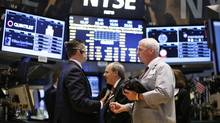 Traders work on the main trading floor of the New York Stock Exchange (NYSE) shortly after the opening bell in New York, in this file photo from May 20, 2013. (Mike Segar/Reuters)