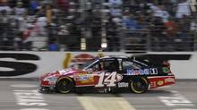 Tony Stewart wins the NASCAR Sprint Cup Series auto race at Texas Motor Speedway in Fort Worth, Tex., Nov. 6, 2011. (Larry Papke/AP)