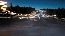 Lights appear to dance on the ski hill as people make their way down the slope at le Massif de Charlevoix, wearing headlamps in the annual torch run in Petite-Riviere-Saint-Francois Quebec. (Jacques Boissinot/The Canadian Press)