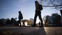 Students walk between buildings on UBC campus in Vancouver, October 29, 2013. (Ben Nelms for The Globe & Mail)