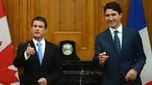 Prime Minister Justin Trudeau, right, and Prime Minister of the France Manuel Valls take part in a meeting on Parliament Hill in Ottawa on Thursday, Oct. 13, 2016. (Sean Kilpatrick/THE CANADIAN PRESS)