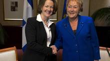 Alberta Premier Alison Redford, left, and Quebec Premier Pauline Marois exchange greetings as the premiers gather for an economic summit in Halifax, Nov. 22, 2012. (Andrew Vaughan/THE CANADIAN PRESS)