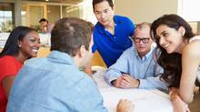 Group Of Architects Discussing Plans In Modern Office (monkeybusinessimages/Getty Images/iStockphoto)