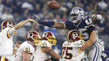 Dallas Cowboys defensive tackle David Irving (95) attempts to block a pass against Washington Redskins quarterback Kirk Cousins (8) in the fourth quarter at AT&T Stadium. Dallas won 31-26. (Tim Heitman/USA Today Sports)