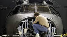 Hans Silvani works on a simulator at CAE Inc., in Montreal, Quebec, April 21, 2010. (Christinne Muschi/Christinne Muschi for The Globe and Mail)