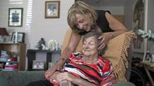 Brenda Hill helps care for her mother Joan Baker, who has Alzheimer's disease, at her mother's home in Caledon East, Ontario on August 2, 2015. (Michelle Siu for The Globe and Mail)