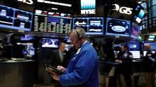 Traders work on the floor of the New York Stock Exchange (NYSE) May 18, 2017. (Brendan McDermid/Reuters)