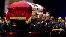 Pallbearers carry the casket of Sgt. Ryan Russell during his funeral in Toronto on Tuesday, January 18, 2011. Thousands honoured Sgt. Russell who was killed by a stolen snowplow on January 12 in Toronto. (Chris Young/The Canadian Press/Chris Young/The Canadian Press)