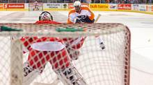 Philadelphia Flyers right wing Wayne Simmonds (17) skates in on net during the overtime shootout against the Detroit Red Wings as a banana lands on the ice at John Labatt Centre. (Tom Szczerbowski-US PRESSWIRE/(2011) Tom Szczerbowski)
