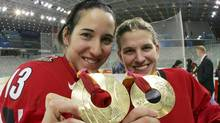 Canada's Caroline Ouellette, left, and goalie Kim St. Pierre celebrate with her gold medal on the ice with champagne after they beat Sweden 4-1 in the Winter Olympics women's ice hockey gold medal game Monday, Feb. 20, 2006, in Turin, Italy. Ouellette was one of four Olympians the NHL has brought in to take part in a fan festival on women's hockey. (AP Photo/Gene J. Puskar) (Gene J. Puskar/AP)