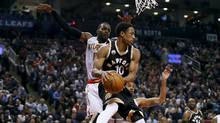 Toronto Raptors guard DeMar DeRozan (10) looks to pass the ball as Atlanta Hawks forward Paul Millsap (4) defends during the first half at the Air Canada Centre on Wednesday, March 30, 2016. (John E. Sokolowski/USA Today Sports)