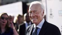 """Christopher Plummer, a cast member in the classic film """"The Sound of Music,"""" arrives for a 50th anniversary screening of the film at the opening night gala of the 2015 TCM Classic Film Festival on March 26, 2015, in Los Angeles. (Chris Pizzello/THE ASSOCIATED PRESS)"""