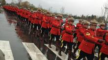 RCMP officers march in formation during the funeral procession for Constable Adrian Oliver, who was killed in a traffic accident in Surrey in November, 2012. (Andrea Woo/The Globe and Mail)