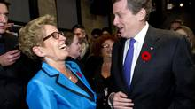 Premier Kathleen Wynne congratulates John Tory on his election win with smiles, a hug and a kiss last week. (Kevin Van Paassen for The Globe and Mail)
