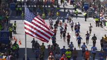 Runners make their way to the finish line of the Boston Marathon, April 21, 2014. (Gretchen Ertl/Reuters)