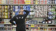 The light bulb aisle at a Toronto Canadian Tire last week. Retailers say demand for incandescent bulbs is lower than a year ago. (Chris Young For The Globe and Mail)