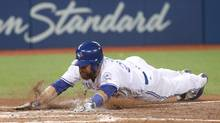 The Blue Jays' Russell Martin slides across home plate to score a run in the fifth inning during Tuesday's game against the Los Angeles Angels at Rogers Centre in Toronto. The Jays won 7-2. (Tom Szczerbowski/Getty Images)