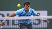 Milos Raonic of Canada hits a return to Alexandr Dolgopolov of Ukraine during a quarter-final match at the BNP Paribas Open on March 13, 2014, in Indian Wells, Calif. (Mark J. Terrill/The Associated Press)