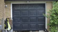 The garage door of an Etobicoke house appears similar to the background of a photo of Rob Ford with Anthony Smith. (J.P. MOCZULSKI FOR THE GLOBE AND MAIL)