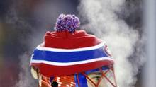 Steam rises from Montreal Canadiens goalie Jose Theodore as he breaths during second period of NHL outdoor action against the Edmonton Oilers at Commonwealth Stadium in Edmonton on Saturday Nov. 22, 2003. (TOM HANSON/CP)