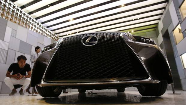 "Visitors look at a Lexus LF-CC concept car during a preview of the ""Intersect by Lexus"" luxury retail space in Tokyo August 23, 2013. (YUYA SHINO/REUTERS)"