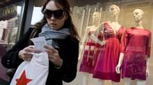 A shopper checks her receipt outside Macy's in New York in this file photo. (MARK LENNIHAN/AP)