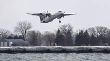 Porter Airline flights take off from Billy Bishop Toronto City Airport on March 24, 2014. (FRED LUM/THE GLOBE AND MAIL)
