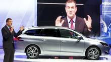 The Peugeot 308 was named the car of the Year for 2014 at the 84th Geneva Motor Show. French auto maker Peugeot's compact beat six other finalists including a pair of electric sports cars, the Tesla S and BMW i3 and a premium Mercedes S Class. (ARND WIEGMANN/REUTERS)