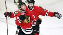 Chicago Blackhawks' Marian Hossa celebrates his goal with Troy Brouwer against the Philadelphia Flyers during the second period of Game 2 of the NHL Stanley Cup final in Chicago May 31, 2010. (JEFF HAYNES/REUTERS)