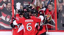 Senators teammates celebrate a first period goal against the Penguins in Game 3. (Sean Kilpatrick/THE CANADIAN PRESS)