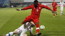 Czech Republic's Marek Suchy, down, challenges for the ball with Canada's Tosaint Ricketts, up, during their friendly soccer match in Oloumouc, Czech Republic, Friday, Nov. 15, 2013. (Petr David Josek/AP)