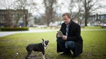 Philip Rooyakkers, founder and CEO of PiP, the Global Pet Recognition Company, demonstrates the PIP My Pet app with his dog Hobbes in Vancouver. (Rafal Gerszak For The Globe and Mail)