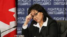 Health Minister Leona Aglukkaq ponders a question during a news conference on the H1N1 flu virus in Ottawa on Friday, October 30, 2009. (FRED CHARTRAND)