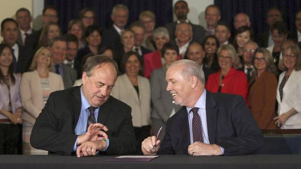 NDP leader John Horgan, left, and his Green Party counterpart Andrew Weaver at the May 30 signing of their pact.
