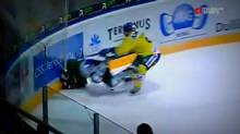 Swiss player Ronny Keller is hit from behind into the boards by Stefan Schnyder (Teleclub Sports screen capture)