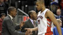 Toronto Raptors center Jamaal Magloire shakes hands with head coach Dwane Casey (L) during the second half of their NBA basketball game against the Indiana Pacers in Toronto January 13, 2012. REUTERS/Mike Cassese (Mike Cassese/Reuters)