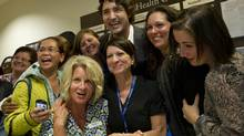 Liberal leadership candidate Justin Trudeau poses with staff at the Maple Health Centre in Vaughan, Ont., on Dec. 4, 2012. (Kevin Van Paassen/The Globe and Mail)