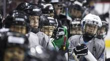 Minor hockey players take part in First Strides put on by the Canucks Hockey Team in Vancouver December 5, 2011. (JOHN LEHMANN/The Globe and Mail)