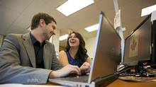 Mark Zanewick and Cassandra Ruggiero at the AIESEC offices in Toronto. (Tim Fraser For The Globe and Mail)