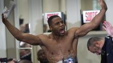 Jean Pascal draws cheers from the crowd during the weigh-in Friday, January 17, 2014 in Montreal. Pascal will face fellow Montrealer Lusina Bute for the WBC Diamond and NABF Light Heavyweight title fight Saturday, Jan. 18, 2014 in Montreal. (Paul Chiasson/THE CANADIAN PRESS)